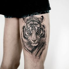 cool tiger tattoo ob thigh for boys by @tattooist_doy