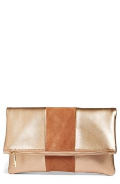 Free shipping and returns on BP. Tonal Stripe Foldover Clutch at Nordstrom.com. A tonal stripe of faux suede adds rich textural contrast to a wear-with-everything fold-over clutch cut from soft faux leather.