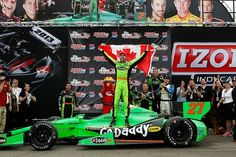 """James """"Hinch"""" Hinchcliffe put Go Daddy in Victory Lane today with his first IZOD IndyCar Series win. The Canadian superstar leaped out of his Go Daddy No. 27 car waving a Canadian flag after running a brilliant race through the St. Petersburg street course."""