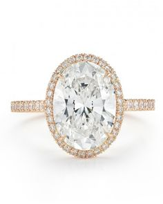 Kwiat 3-carat oval-cut diamond with pavé diamond frame set in 18-karat rose gold