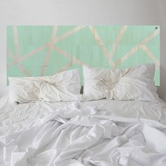 Minty goes to Mayfair. Be inspired by the thoughtfully designed MUSE headboard in Mint Green. Strips of natural wood are revealed between the coloured sections of Mint Green.
