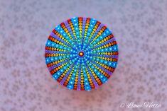 Painted rocks sea urchin by Liona Hotta Pebble art rainbow Painted stone Mandala Stone Feminist gift Feminism Mindfulness gift Zen Garden #etsy #art #painting #rainbow #beautifulmandala #colourfulmandala #handpainted #mandala #mandalaart #mandalapainting