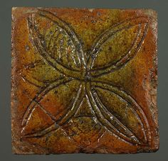 Medieval floor tile from Talley Abbey in Wales.