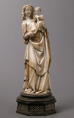 My favorite at Metropolitan Museum of Art, NYC - Virgin and Child, ca. 1320-30, ivory with traces of polychromy gilding, wooden base