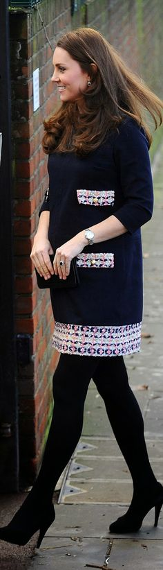 Catherine, Duchess of Cambridge was glamorous in a loose-fitting maternity dress by Madderson that showed a hint of bump.