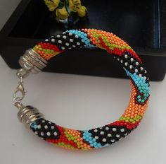 Hey, I found this really awesome Etsy listing at https://www.etsy.com/listing/229844865/kaleidoskop-beaded-crochet-bracelet