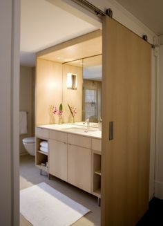 I love the new use's for barn doors in interior design.  doing this in my master bath!