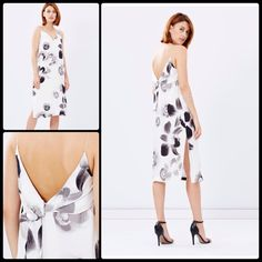 """TALULAH  Superstition Shift Dress NWT The Talulah Superstition Shift Midi Dress falls relaxed around the body forming a modern shift silhouette.  I love the monochrome blooms which lend the piece a soft femininity.     model is wearing a size small dress. 5'11"""" (180cm) tall and has a 62cm waist.   - Length: 112cm - Relaxed fit - Matte satin; fully lined   - Digital floral print - V-neckline; spaghetti shoulder straps - Gathered tie embellishment on the back  - Invisible zip fastening…"""