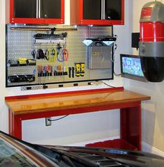 We wouldn't mind spending a weekend hanging around in this garage. With the game on the TV and Wall Control Metal Pegboard taking care of the tool storage, we could tinker around on stuff all afternoon! Thanks for the great customer submission Robert! We like what you did with the black molding around the panels as well, very nice!