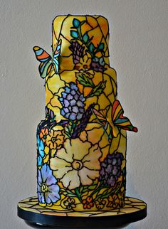 Art Nouveau style artsy wedding cake..Art Nouveau Wow, the detail on this stained glass window cake is amazing! With nods to the beautiful art nouveau period, this three tiered cake from Daisy Molly and Me would be a great talking point for the guests.