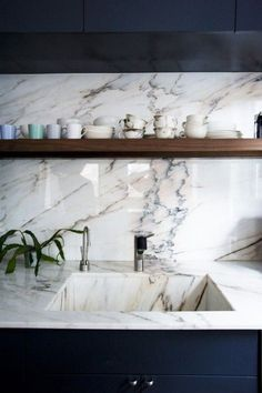 white marble countertops and navy cabinetry