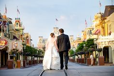 Stroll down Main Street, U.S.A. with the one you love at a bridal portrait session. I want to do a photo like this for my future wedding at Disneyland. <3
