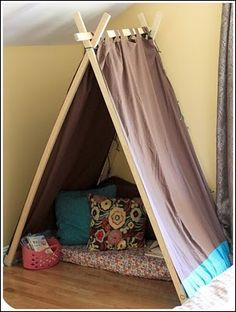 DIY tent out of tabbed curtains. Cute idea for reading area. Will see if I have room. Ema would love it.
