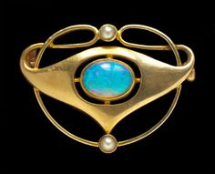 This is not contemporary - image from a gallery of vintage and/or antique objects. MURRLE BENNETT & Co 1896-1916  Art Nouveau Brooch  Gold Opal Pearl