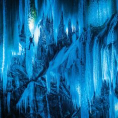 Chasing frozen waterfalls: Climbers scale and light up icy caves for stunning photos - It is so cold in Eidfjord, Norway, that the waterfalls have frozen to ice. Climbers Daniel and Stephan Siegrist placed the lamps behind the icefalls and then posed for the camera to create the surreal shots. (PHOTOPRESS/Thomas Senf/Mammut)Yahoo News UK