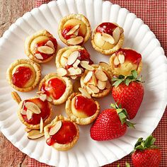 Strawberry Cheesecake Tartlets - A filling of yummy strawberry preserves crown the top of each of these bite-size cheesecake cookies.