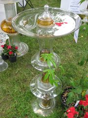 stacked glass dishes bird bath
