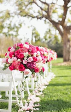 pink flower bouquets down the aisle