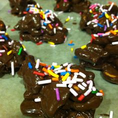 Chocolate Goldfish® Pretzel Clusters Melt a bag of semi sweet chocolate morsels in the microwave for 1 min, and 15 sec intervals thereafter, stirring in between until melted and smooth. Add Goldfish® pretzel crackers and stir to coat. Drop the chocolate mixture by tablespoonfuls onto a baking sheet lined with wax paper. Sprinkle with sprinkles and refrigerate for 30 minutes. Chocolate Morsels, Wax Paper, Baking Sheet, Goldfish, Pretzel, Crackers, Sprinkles, Microwave, Smooth