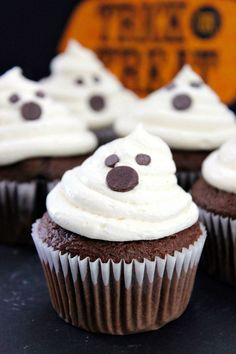 "Adorably Cute Halloween Ghost Cupcakes - this dessert recipe is easy to make with chocolate cake mix and marshmallow creme frosting. Perfect ""not-too-spooky"" treat for a Halloween party!"