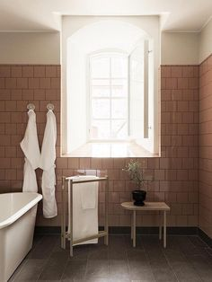 Steal This Look: A Swedish Bathroom with Retro Pink Tiles – Remodelista - Modern Scandinavian Bathroom, Scandinavian Home, Wooden Clothes Drying Rack, Pink Tiles, Bespoke Furniture, Nordic Design, Bathroom Wall, Bathroom Pink, Bathroom Ideas