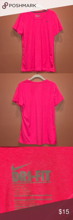 Nike Dri Fit Top Hot Pink Beautiful hot pink Nike Dri Fit Women's too. Sz Large. Only worn a few times. In excellent condition. Please comment below if you have any questions! #neon #nike #pink #hotpink #drifit Nike Tops Tees - Short Sleeve