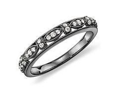 Lovely medieval feel to this stackable ring. White gold, diamonds and rhodium.