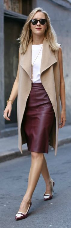 burgundy leather skirt, white tank, camel sleeveless coat, spectator heels…