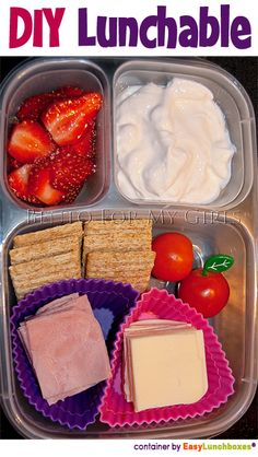 DIY Lunchable - Cut a couple slices of deli ham into 6ths and quartered a couple slices of american cheese.  Whole wheat crackers, cherry tomatoes, homemade yogurt and some sliced strawberries.