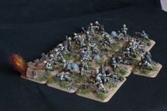 German Falschrimjager Pioneer Platoon based on custom bases in an attack on a prepared position. Painted by Panzerschule for Worlds at War.