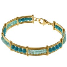 This exquisite Michael Valitutti Kristen bracelet features beautiful apatite and turquoise beads. Crafted of Sterling silver with 18-karat yellow gold-embrace, this bracelet shines with a highly polished finish.