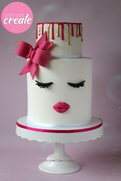 Lips and lashes cake with a pink bow and pink and gold drip - by Love Cake Create