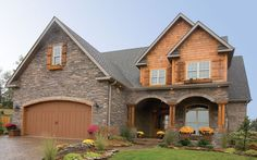 Rustic Country Craftsman style house design - love all the stone work