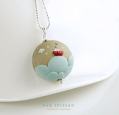 Polymer clay pendant by Eva Thissen. Made using the appliqué technique, sometimes known as the embroidery technique.