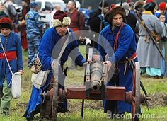 RUSSIA, MOLODI VILLAGE - JULY 27: Unidentified people stand by the cannon  on event dedicated to Victory in battle near the Molodi village 1572, on July 27, 2013, in Moscow region, Russia Пушкари развертывают огневую точку