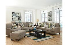 """The Hariston - Shitake Sofa from Ashley Furniture HomeStore (AFHS.com). With the unique pleated upholstered look of the stylishly shaped set-back arms and accent welting details adorning the plush comfortable cushioning, the """"Hariston-Shitake"""" upholstery collection takes the relaxed Vintage Casual style and infuses it with the comfort you have been dreaming of."""