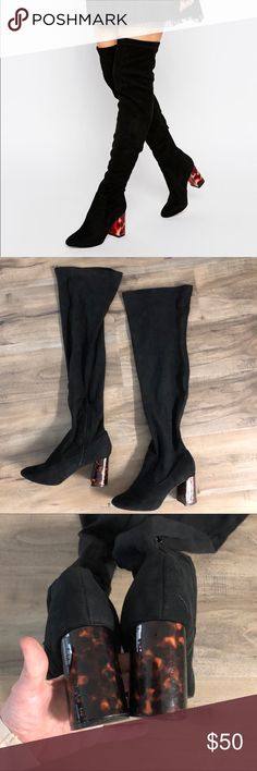 """Black over the knee boots with tortoise shell heel Cute black faux suede over the knee boots. Side zippers. Tortoise shell heels. Worn a few times so there is a bit of scuffing and small marks on the heels and bottoms of the shoes. 3"""" heels. 25"""" tall from bottom of heel to top of boots. Laying flat calf width is 7"""". Size 7 but they are marked with asos' UK sizing which is 5. A UK 5 = US 7. ASOS Shoes Over the Knee Boots"""