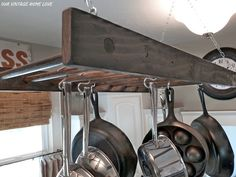 Hanging pot rack made from an old wooden ladder. I will have one of these...over my island!