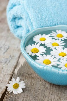 Flowers stay fresh for longer when kept in water, so you can do that in any plain but trendy bowl