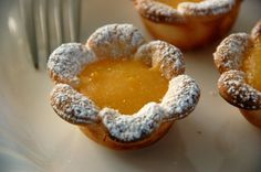Lemon tarts ... using flower-shaped cookie cutter to cut out the pie crust..... GREAT idea!