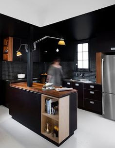 Black kitchen, brown counters. That's how it should be done.