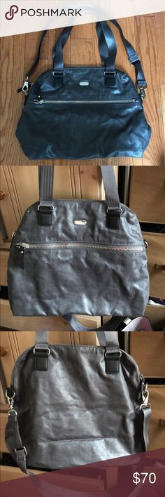 Dark grey metallic large shoulder bag Kipling large shoulder bag in dark grey subtle metallic fabric, slightly shimmery for just a touch of shine! Nylon straps fit comfortably over shoulders with detachable crossbody strap. Silver zippers, large gauge front zip pocket. Interior zip pocket and also slip pockets for your cell phone. Measures approx 18 x 13 x 6 inches. Slight blemish to the right of the front logo, as shown in the last photo, otherwise in great condition with clean interior…