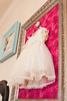 Great idea for heirloom clothes, softer pink background with white frame