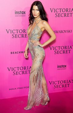 BELLA HADID sports a bedazzled sheer strappy Julien Macdonald gown with a plunging neckline and cut-outs, paired with strappy metallic Jimmy Choo sandals and Messika Paris jewelery at the Victoria's Secret Fashion Show after party in Paris.