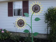rotary hoe flowers | sunflower made from John Deere rotary hoe wheels