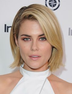 Rachael Taylor Give your bob extra volume at the crown with a deep center part. No product necessary.