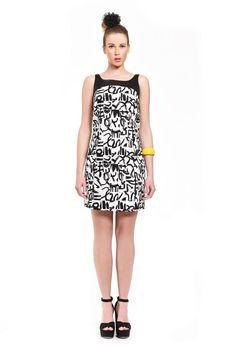 c154c3da1fdb Φόρεμα εμπριμέ καπαρντίνα αμάνικο πάνω από το γόνατο σε ίσια γραμμή με  μονόχρωμες λεπτομέρειες