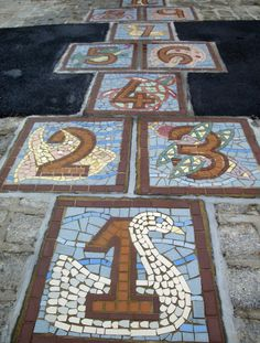 12 x 12 cement tiles, mosaic on top, set with mortar, seal with water proof sealer. place in brick walk.