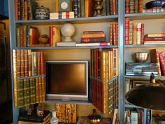 """Garrow Kedigian is All Grown Up - love how the """"books"""" cover up the TV!!"""