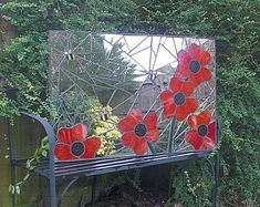 Mosaic garden mirror (3 ft x 2ft). Handmade using stained glass and recycled mirror.